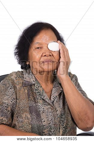 Medicine plaster patch on old woman injury wound eye on white background poster