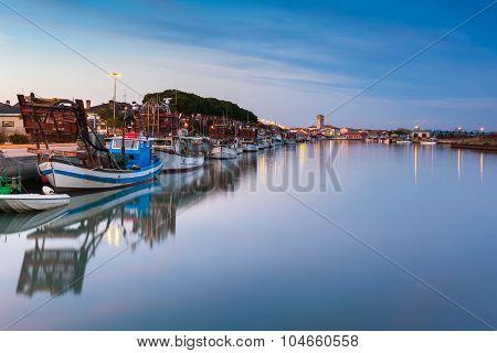 View at sunset of the fishing village of Marano Lagunare. Adriatic coast of Friuli Venezia Giulia. Italy. poster