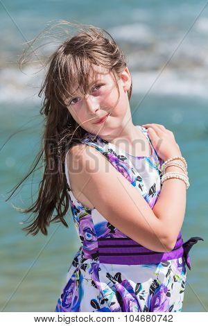 Cute preteen long hair girl posing on riverbank poster