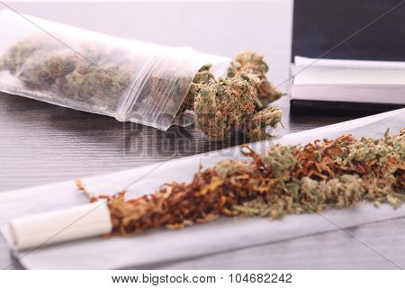 Dried Cannabis On Rolling Paper With Filter