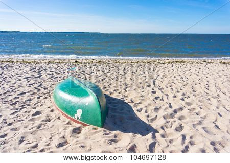 Empty boat on sand at a beach