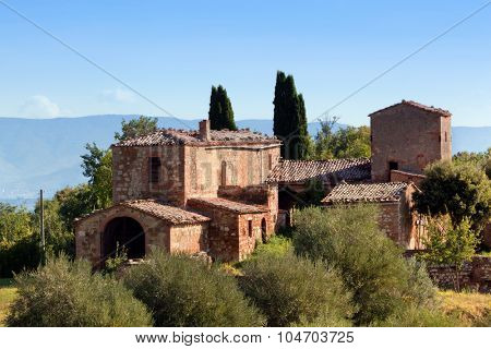 A residence in Tuscany, Italy. Typical for the region tuscan farm house, hills, cypress trees. Italy