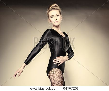 Graceful beautiful woman ballet dancer studio shot gray background poster