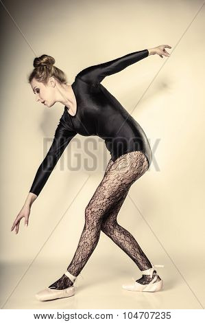 Graceful beautiful woman ballet dancer full length studio shot gray background poster
