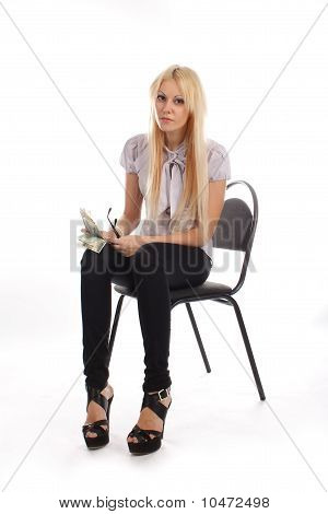 Businesswoman With Money On Office Chair