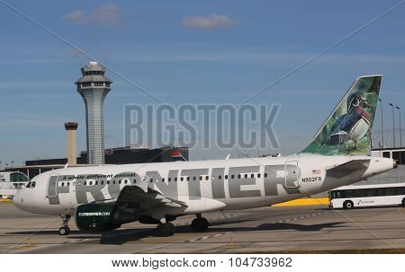 Frontier Airbus 319 aircraft taxing at O'Hare International Airport in Chicago