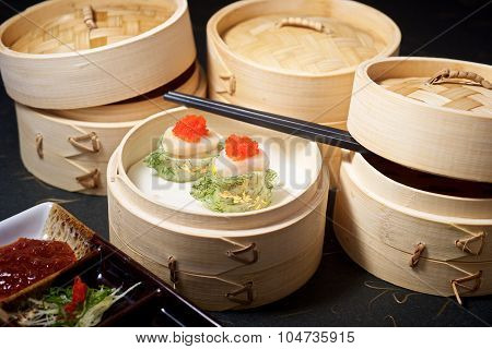 Gourmet Yumcha Dimsum Set in bamboo container with chopstick on black ground poster