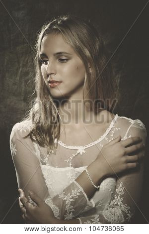 young woman in white lacy dress studio portrait, retro colors