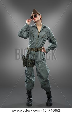 Sexy Girl Dressed As A Helicopter Pilot Posing In Sunglasses