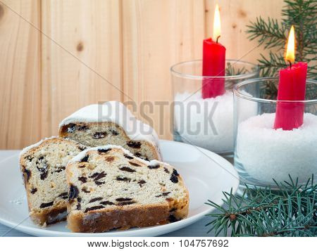 Stollen, Christmas Tree And Red Burning Candles