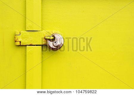 Rusty Padlock On Old Painted Metal Door