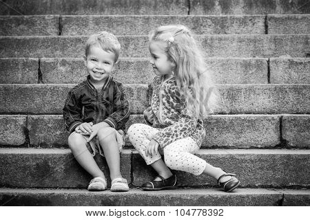 Happy Toddler Children Sit On The Steps