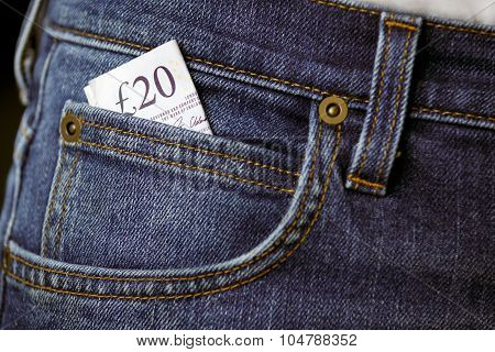 Twenty Pound Bank Banknote In The Pocket Of Jeans. United Kingdom. Background.