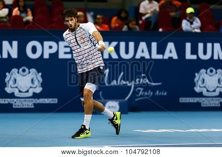 KUALA LUMPUR, MALAYSIA - OCTOBER 02, 2015: Spain's Feliciano Lopez plays a backhand return in his match at the Malaysian Open 2015 tennis tournament held at the Putra Stadium, Malaysia.