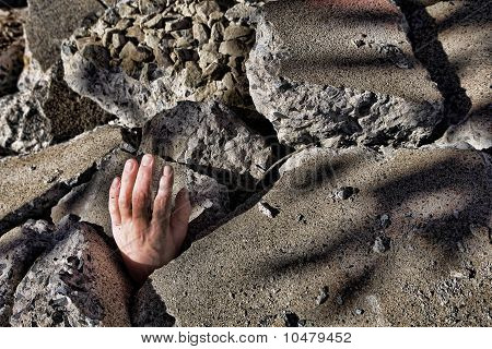 Dead Man's Hand Sticking Out Of Concrete Rubble After An Earthquake