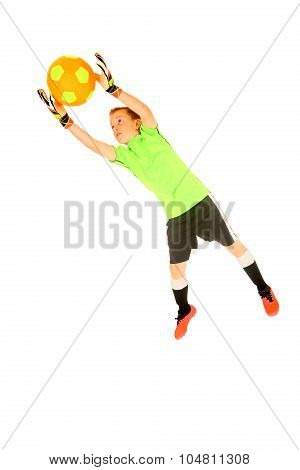 Young Boy Soccer Goalie Jumping To Save From Goal