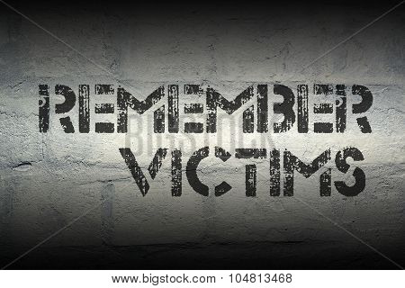 remember victims stencil print on the grunge white brick wall poster