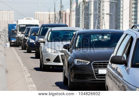 Generic cars standing in a queue during traffic jam poster