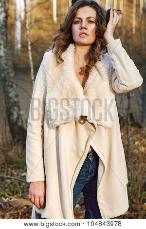 Portrait of fashionable woman in autumn park