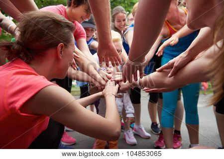 jogging people group, friends have fun,  hug and stack hands together after training