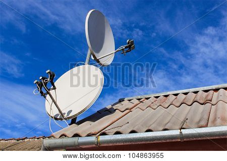 Two white satellite dish on the roof