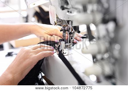 Sewing on a machine.