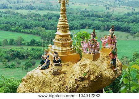 Famous sacred balancing golden rock at Wat Phra That Doi Din Chi in Mae Sot, Thailand.