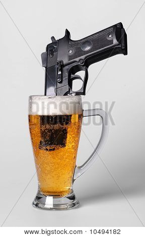 A pistol in a beer glass
