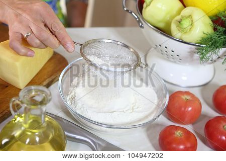 The Woman Sifts A Flour
