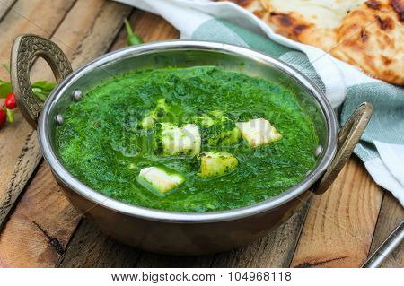 Palak Paneer Indian vegetarian curry made with spinach sauce and cottage cheese poster
