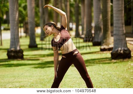 Woman Doing Stretching Before Sports Training At Morning-2