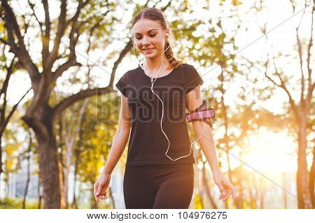 Young Beautiful Athlete Girl Training Precision With Armband