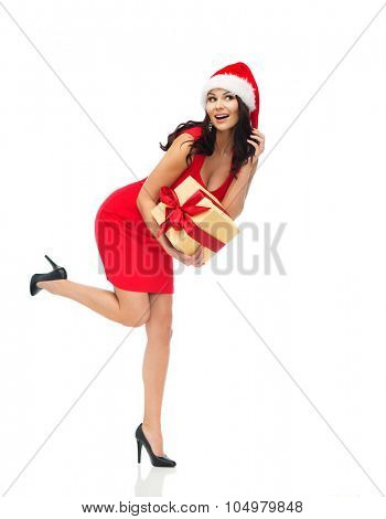 people, holidays, christmas and celebration concept - beautiful sexy woman in red dress and santa hat with gift box listening to something