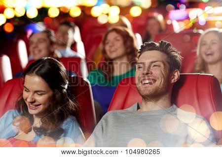 cinema, entertainment and people concept - happy friends watching comedy movie in theater poster