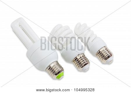 Three Compact Fluorescent Lamp On A Light Background
