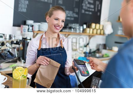 Waitress serving customer at the coffee shop