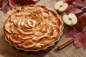 Gourmet traditional holiday apple pie sweet baked dessert food with cinnamon and apples on vintage background. Autumn decor. Rustic style and natural light. poster