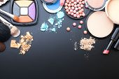 Makeup cosmetics products on dark background with copy space. Cosmetics make up artist objects: lipstick, eye shadows, eyeliner, concealer, nail polish, powder, tools for make-up. Selective focus poster