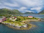 Aerial view of tourist resort with Sildpollnes Church on Lofoten islands in Norway poster