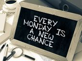 Every Monday is a New Chance. Inspirational Quote Handwritten on Chalkboard. Composition with Small Chalkboard on Working Table with Ring Binders, Office Supplies, Reports. Blurred, Toned Image. poster