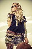 Fashion shot of a beautiful boho style girl over sky background. Boho, hippie. poster