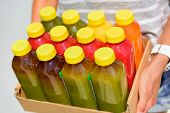 Organic cold-pressed raw vegetable juice plastic bottles. Latest food trend consisting of juicing at high pressure fresh fruits and vegetables without heating to preserve nutrients and vitamins. poster