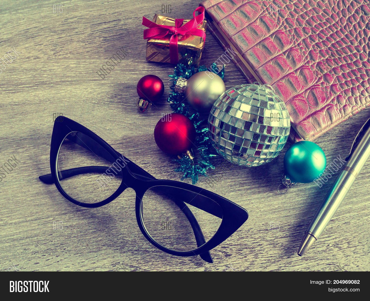 Business Christmas office on workplace with a tie pen glasses and Christmas decorations. Business and