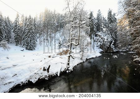 Winter river with snow in the Czech Switzerland
