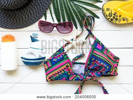 Fashion summer swimsuit bikini sunglasses and big hat on rope. Summer bikini and accessories stylish outfit beach set. Ocean sea vacation. Summer Concept