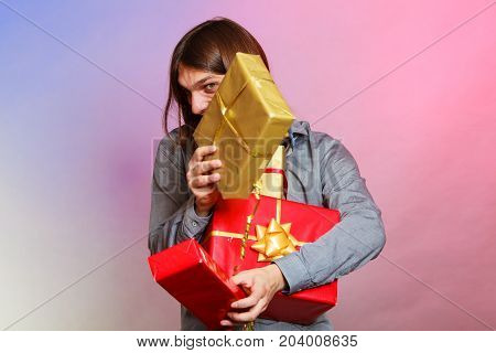 Holiday xmas winter time season and special occasion. Young handsome stylish man holding a lot of presents gifts boxes