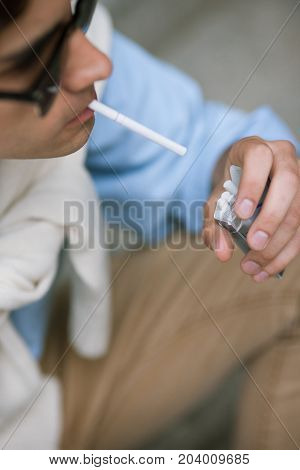Unhealthy lifestyle. Smoking male closeup. Young unrecognizable man with bad habits, modern youth, hipster concept
