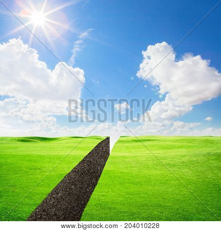 Green field with abyss under blue sky
