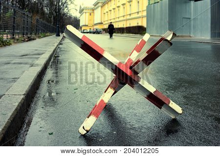 Welded from steel profiles bar on street asphalt in the city of St. Petersburg in Russia in autumn