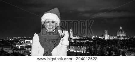 Woman In Christmas Hat In Front Of Panoramic View Of Florence